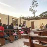Worshipping at 6:30 a.m. Sunday in Haiti. The hurricane ripped the roof off the church, so services start early to beat the heat.